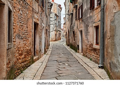 Vodnjan, Istria, Croatia: picturesque old alley with ancient houses in the medieval town near Pula