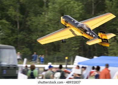 VOGHERA, ITALY - MAY 21: Aerobatic Lithuanian pilot engineer Jurgis Kairys flying by side at low altitude at  Voghera Air Show may 21, 2006 in Rivanazzano (Voghera), Italy.