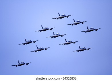"""VOGHERA, ITALY - MAY 21: Aerobatic team """"Frecce Tricolori """" of the Italian Air Force on aircraft Aermacchi MB-339-A/PAN in flight  at  Voghera Air Show on May 21, 2006 in Rivanazzano (Voghera), Italy."""
