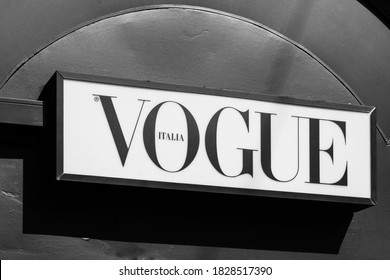 Vogue brand logo sign on a newspaper kiosk. Vogue is monthly fashion and lifestyle magazine covering many topics, including fashion, beauty, culture, living, and runway. Milan, Italy - 24.09.2020
