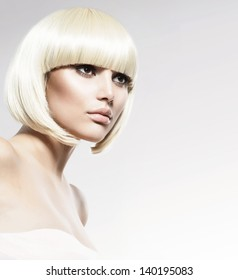 Vogue Style Beauty Fashion Model Portrait. Haircut. Hairstyle. Hairdressing. Fringe. Beautiful Glamour Girl with Short Blond hair
