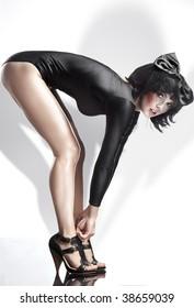 Vogue style photo of a beautiful brunette beauty