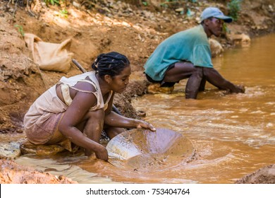 Vohemar, Madagascar, May 22, 2017: Malagasy couple of gold panners in the river near Vohemar in Eastern Madagascar
