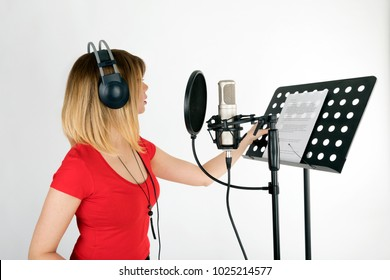 Voice acting woman performing a dubbing scene, isolated white background