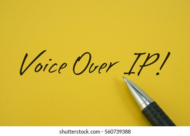Voice Over IP (VOIP)! note with pen on yellow background