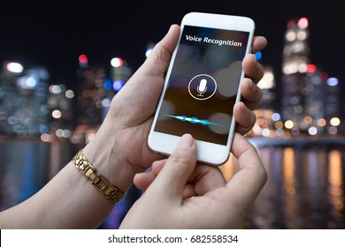 Voice recognition , speech detect and deep learning concept. Application on mobile phone screen city night time bokeh background.
