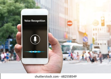 Voice recognition , speech detect and deep learning concept. Application on mobile phone screen with blur city background.