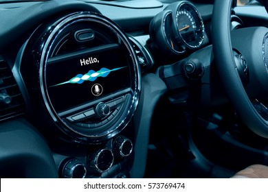 Voice recognition , speech talk and internet of things in smart car concept. Car 's console show application display and sound wave.