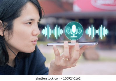 Voice recognition,search technology concept.Close-up of woman talking on her mobile phone