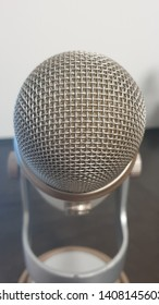 Voiceover microphone tilted, soft focus