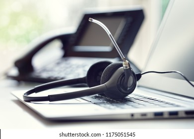 VOIP headset headphones telephone and laptop concept for communication, it support, call center and customer service help desk