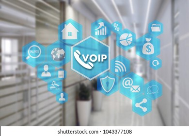 VOIP on the touch screen with a blur background of the office.The concept of Voice over Internet Protocol