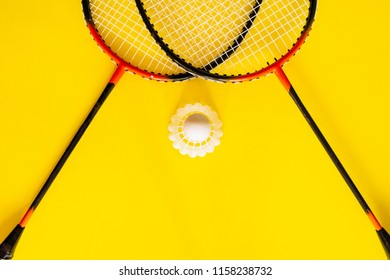 Volant and racket, badminton on yellow background. Concept excitement, resistance, competition. Pop Art