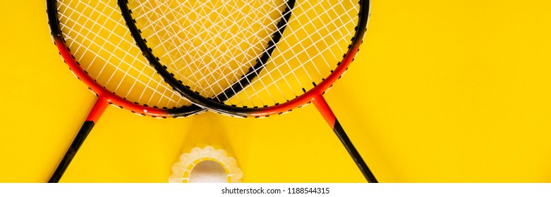 Volant and racket, badminton on yellow background. Concept excitement, resistance, competition. Pop Art Banner