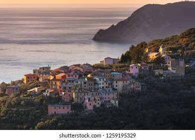 Volastra, Riomaggiore, Cinque Terre (Five Lands), Liguria, Italy: Sunset aerial view of a village perched on a hill, typical colorful houses. Cinque Terre National Park is a UNESCO World Heritage Site