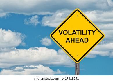 Volatility Ahead Caution Sign - Blue Sky Background
