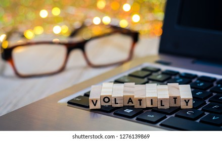 Volatility still life business finance concept with laptop, stock chart, shallow DOF