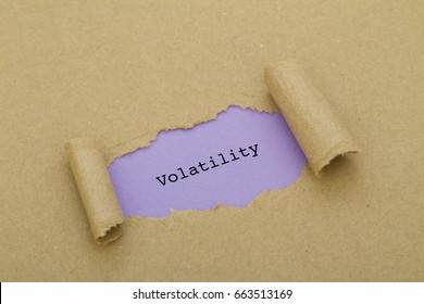 VOLATILITY word written under torn paper.