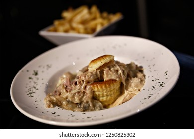 A vol-au-vent which is a small hollow case of puff pastry with french fries served in plate in restaurant in Brussels, Belgium on Dec. 5, 2018