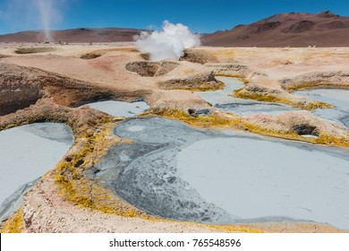 Volcanic activity with fumaroles and mud pits at Sol de Mañana, together with a small tornado, near the Uyuni Salt Flat, Bolivia.