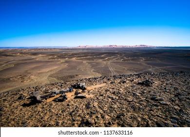 Volcanic black basalt terrain in Sahara desert in Morocco
