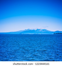 Volcanic cones of Ruapehu towering over great lake of Taupo on a beautiful sunny day. Natural background. North Island Volcanic Plateau, New Zealand