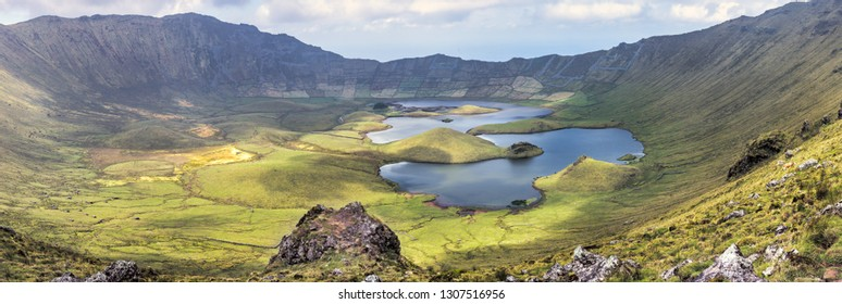 The volcanic crater (Caldeirao) with a beautiful lake on the top of Corvo island. Azores islands, Portugal