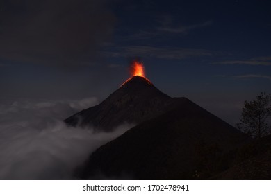 Volcanic Eruption over the Clouds at the Acatenango sisters volcano, Volcan del Fuego explosion