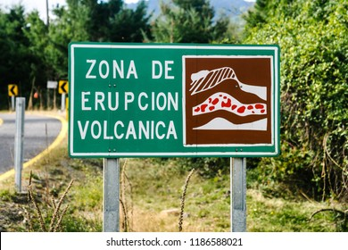 """""""Volcanic Eruption Zone"""" street sign in Spanish wear lava is likely to flow during an eruption in Chile"""