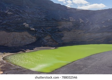 Volcanic green lake (El Lago Verde, Charco de los Clicos) in El Golfo. Lanzarote. Canary Islands. Spain