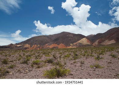 Volcanic landscape in the cordillera. View of the arid desert and colorful mountains under a beautiful sky.