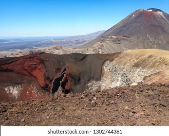 volcanic landscape with Mount Ngauruhoe (Mount Doom) and red crater, view from popular hiking trail for tourists and backpackers Tongariro Alpine Crossing,  Tongaririo National park, New Zealand