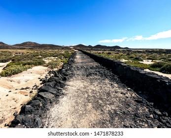 Volcanic landscape in the natural park of Isla de Lobos, in Fuerteventura, Canary Islands, Spain