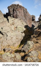 Volcanic landscape near the caves of Gorelyi volcan, Kamchatka. Big black boulders of frozen lava.