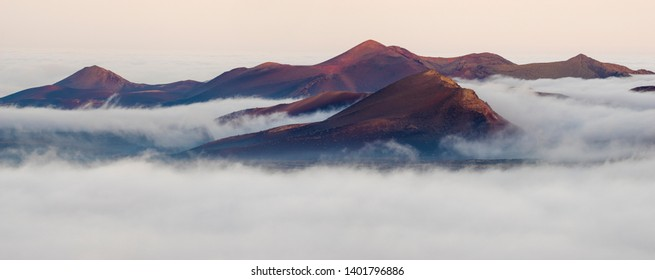 volcanic peaks above clouds in national park Timanfaya in Lanzarote