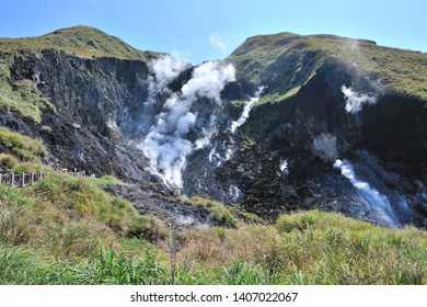 Volcanic rock area with white smoke and autumn color landscape