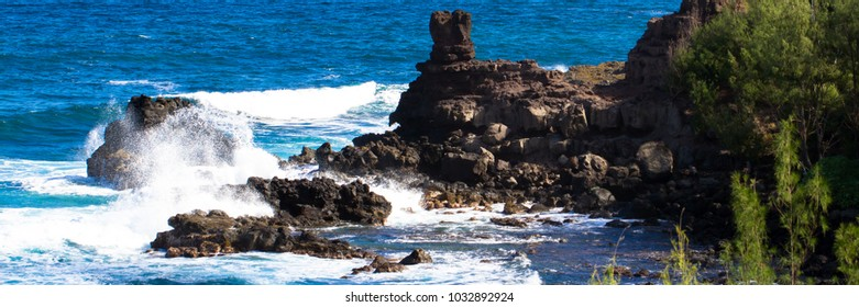 Volcanic rock and shades of blue water on the northwest coast of Maui
