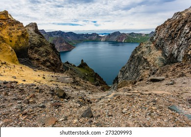 Volcanic rocky mountains and lake Tianchi, wild landscape, national park Changbaishan, China.