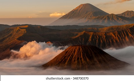 Volcano Bromo with sulfur, fog and mist at sunrise near Malang in Indonesia