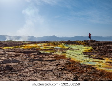 Volcano Dallol/Ethiopia -02/02/2019 : man observes landscape of volcano Dallol