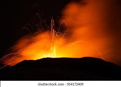 Volcano eruption. Mount Etna erupting from the crater Voragine.