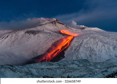 Volcano Etna Eruption - lava flow through the snow