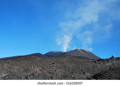 Volcano Etna on Sicily, Italy. Mountain and Hills Landscape with burned black magma earth.