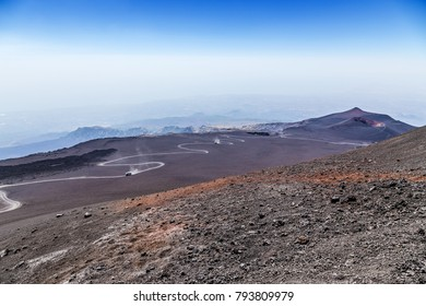 The volcano of Etna, Sicily, Italy. Buses-cross-country vehicles with tourists on mountain serpentine