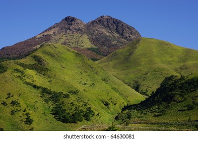 Volcano and a hill and a blue sky