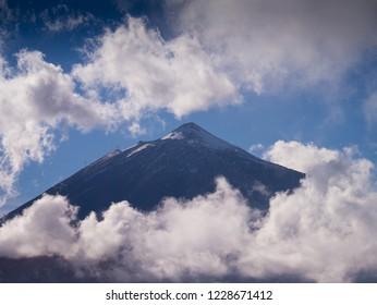 Volcano Teide at the Island of Tenerife covered by clouds