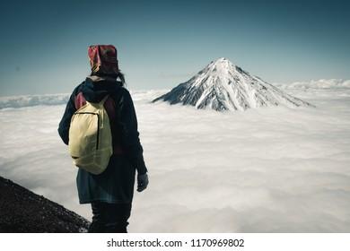 Volcano view with girl, Kamchatka,  Karyachinsky