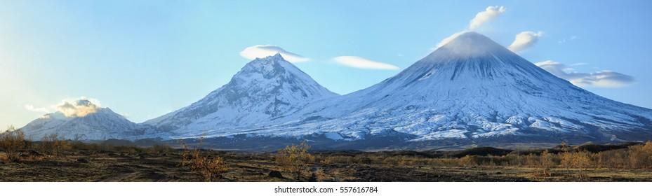 Volcanoes Bezymianny(2880m,active) Kamen(4585m) Klyuchevskoy(4800m,active) Russia,Kamchatka Peninsula.The volcano of Klyuchevskaya sopka. (4800 m) is the highest active volcano of Eurasia.