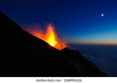Volcanoes eruption with snow in autumn season
