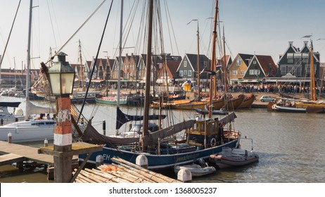 Volendam, Netherlands - April 7, 2019: View of the Volendam harbour and historic flat bottom ships called botters. Ships participating in the annual Pieper Race that opens sailing season in April.